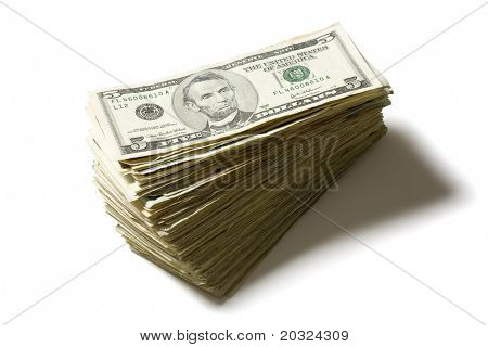 Stacked five dollar bills isolated on a white background