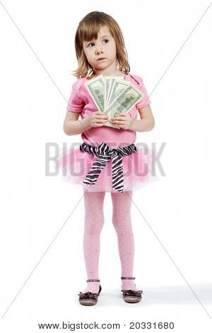 Little girl in pink with dollar banknotes in her hands.