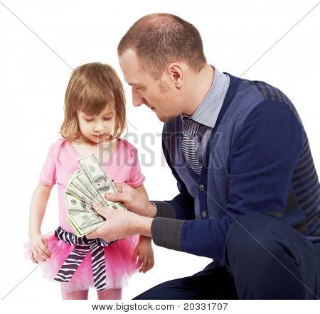 A man shows dollar notes opened as fan to little girl.