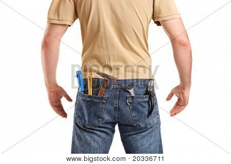 Male worker with tools in back pocket on jeans isolated on white background