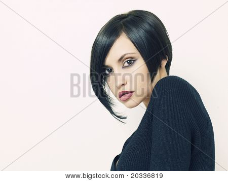 Photo of young beautiful woman with short hairstyle