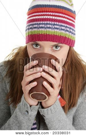 Young woman in winter hat with cup of hot chocolate or coffee or tea
