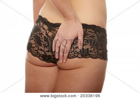 Closeup of young woman with hand on her buttock isolated