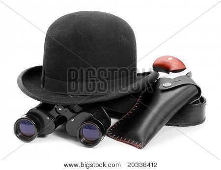 Black bowler hat, spyglass and pistol. Vintage detective equipment on white background.