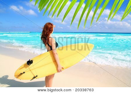 surfer woman side view tropical sea looking waves Caribbean sea