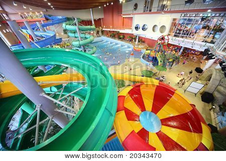 "MOSCOW - MARCH 21: Large varicoloured chutes as spiral and pool in ""Kva Kva"" park  on March 21, 2010 in Moscow , Russia. ""Kva kva"" park opened on November 5, 2006 year."