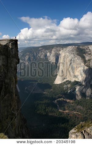Hiker overlooking Yosemite Valley from Taff Point