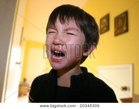 Three years old boy having tantrum