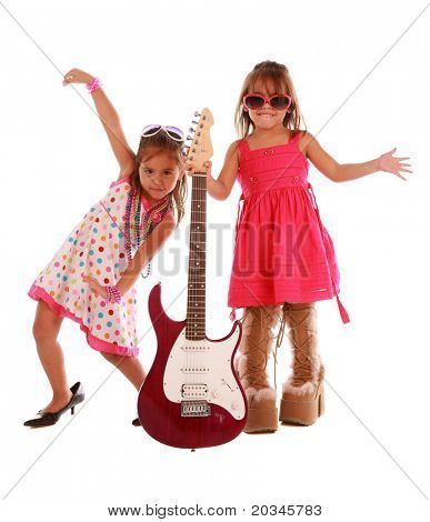 Two adorable sisters dancing on pure white background