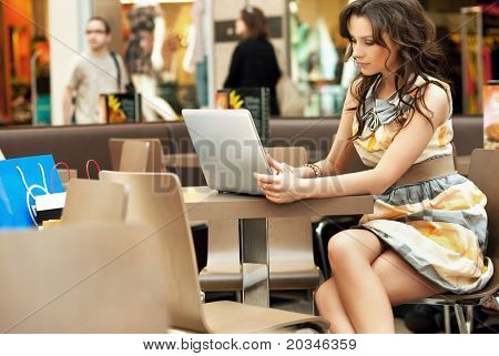 Young lady browsing the Internet at the cafe