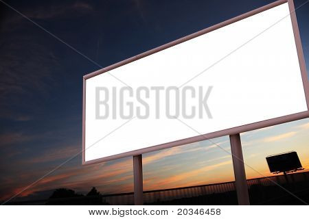 Blank billboard over evening sky