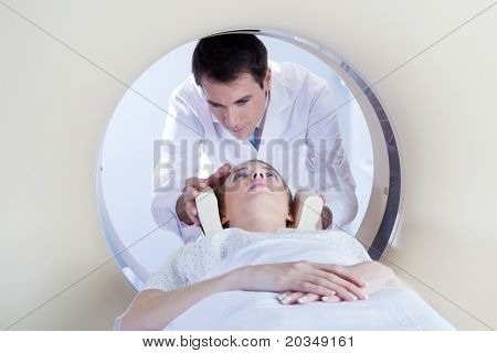 Technologist preparing the patient for a CT scan in hospital