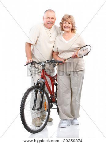 Senior couple with velo . Over white background