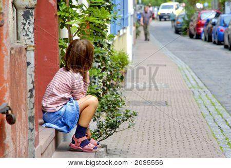 Little Girl Waits At Door