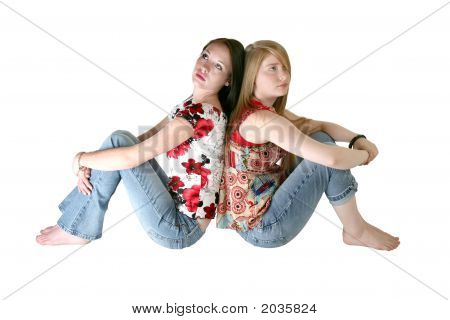 Beautiful Teen Sisters Over White