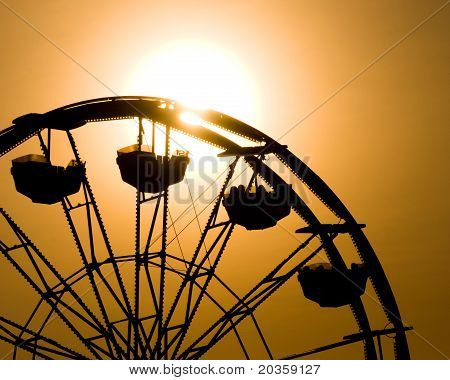 Silhouette of ferris wheel