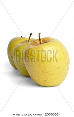 Three yellow delicious apples