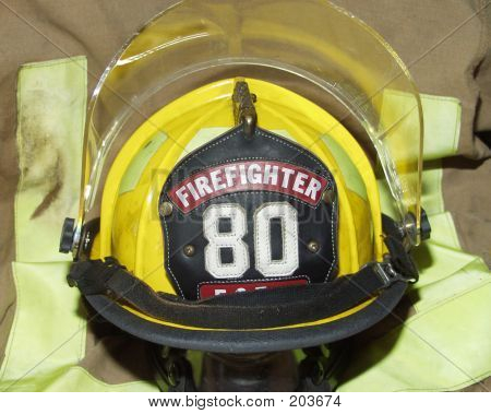 Firefighter Helmet On Burnt Jacket