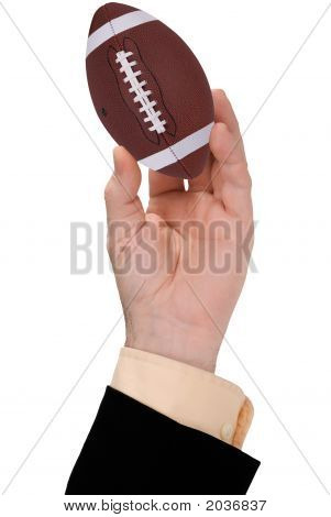 Businessman Hand Holding A Football