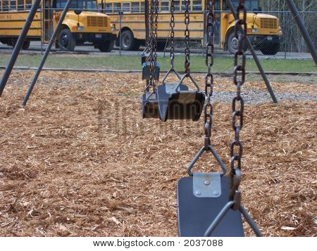 Swings With Buses In Background