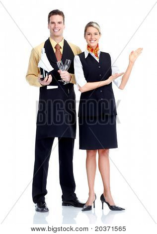 Young  smiling waiter and waitress. Isolated over white background