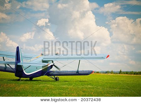 Vintage single-engine biplane aircraft ready to take off