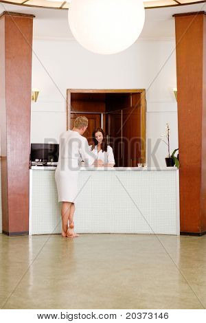 A functionalism (funkis) spa interior with a man choosing a therapy package