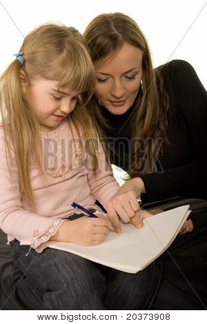Little girl drawing with her mother