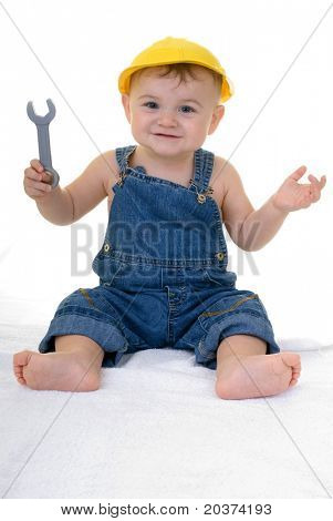 baby mechanic holding wrench, copy space left below