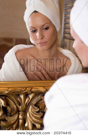 beautiful girl is getting ready in front of the mirror