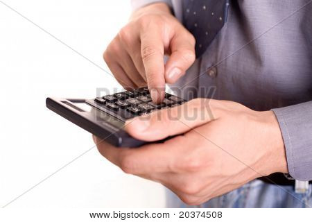 businessman holding calculator, focus on the finger on number 5