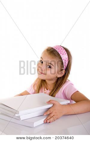 schoolgirl with a stack of books, copy space on the top