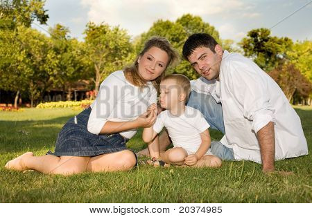 happy family at the park on a sunny day