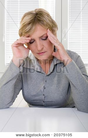 senior woman in 50s having headache