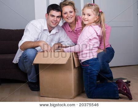 young family moving house, real estate concept