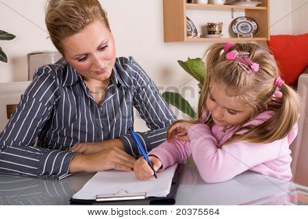 mom is helping her daughter with homework