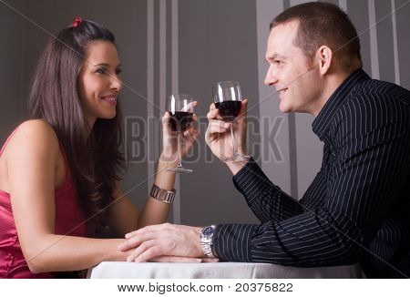 young couple in love drinking wine