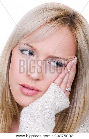 young woman in pain is having toothache or headache