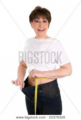 happy mature woman on a diet losing weight