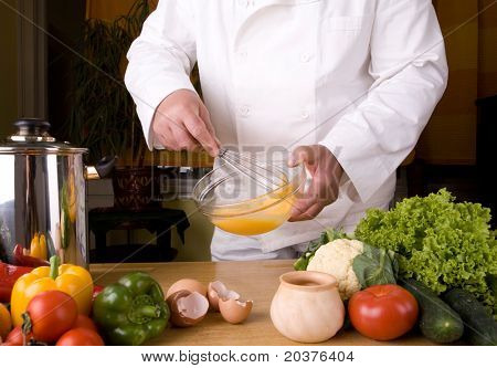chef preparing healthy meal in the kitchen