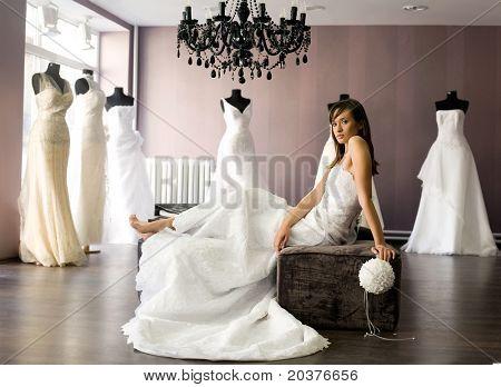 bride at the salon in wedding dress