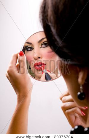 beautiful woman putting on makeup, retro style
