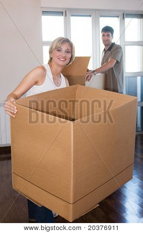 young couple in love moving house