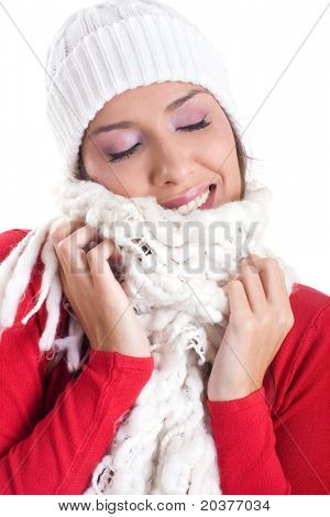 beautiful woman wearing woolen hat and scarf in winter