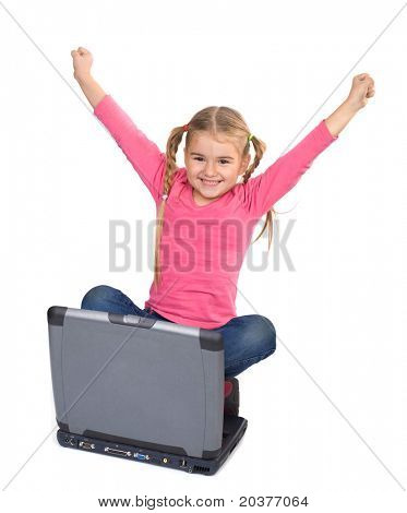 happy girl holding hands up for winning computer game or learning a lesson