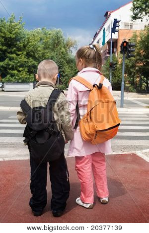 two children crossing the street