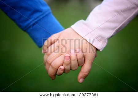 two children holding hands