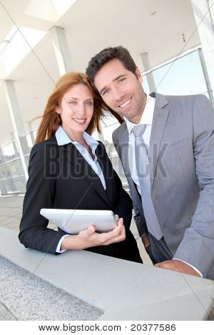 Business team meeting outside the airport