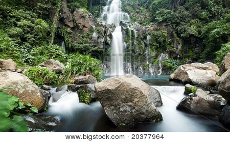 Slow shutter for moving water at Trois Bassin waterfall on Reunion Island