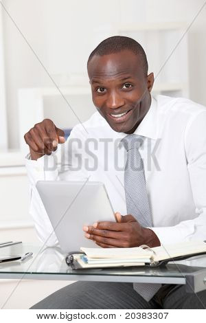 Businessman using electronic tablet in office